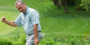Man celebrating golf putt
