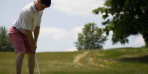 Man getting ready to hit golf ball