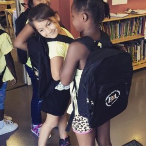 Girls wearing Believe & Achieve Backpacks