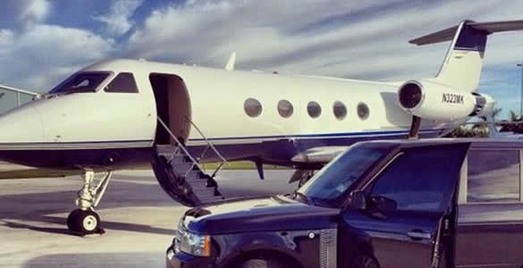 Private Jet on Runway with Car